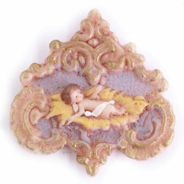 Medaillion mit Jesulein im Stroh aus handbemaltem Wachs