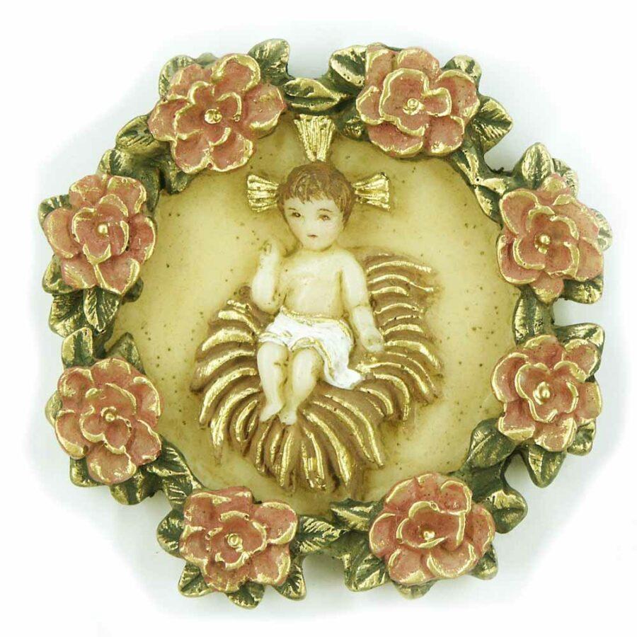 Medaillion mit Jesukind im Strohbett mit Rosenranke