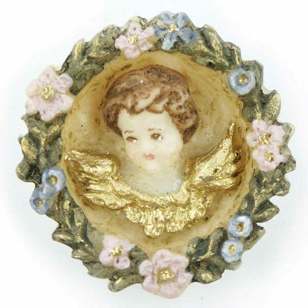 Medaillion mit Engelkopf in einer Blütenranke