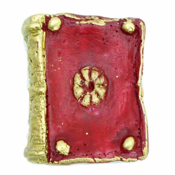 Buch mit goldener Umrahmung aus Wachs für Klosterarbeiten