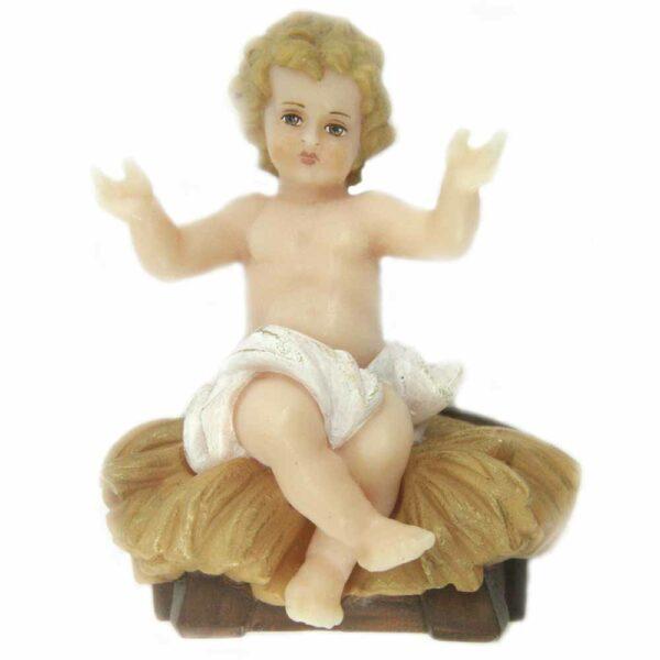 Jesulein im Stroh sitzend mit gebreiteten Armen aus Wachs