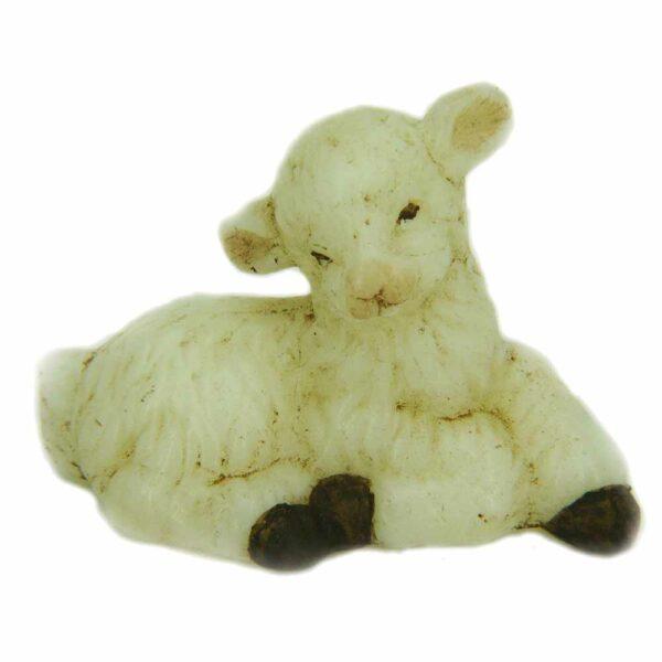 Kindliches Schaf liegend in Wachs