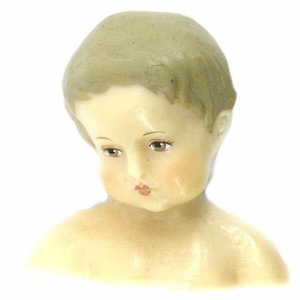Fatschenkindlkopf aus Wachs mit gemalten Haaren