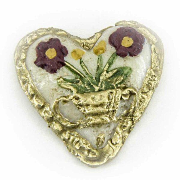 weißes Herz mit Blumenvase und goldenem Rand in Wachs
